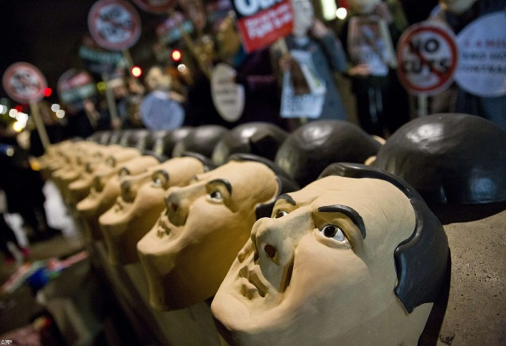 Rubber masks of British Chancellor George Osborne are lined up by Anti-austerity protesters last year