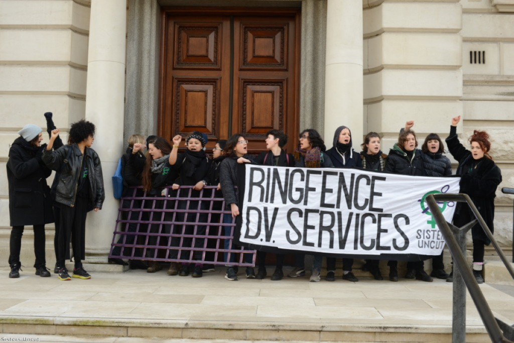 Sisters Uncut protest outside the Treasury ahead of the budget this week