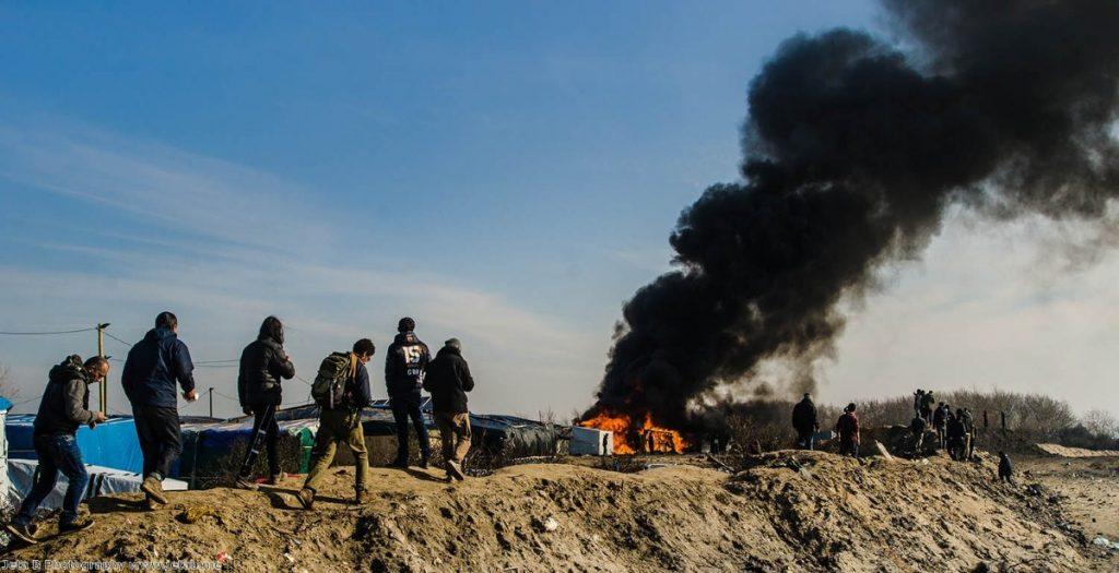 "Caroline Lucas: ""Smoke and flames rose sporadically into the sky as parts of the camp burn"""