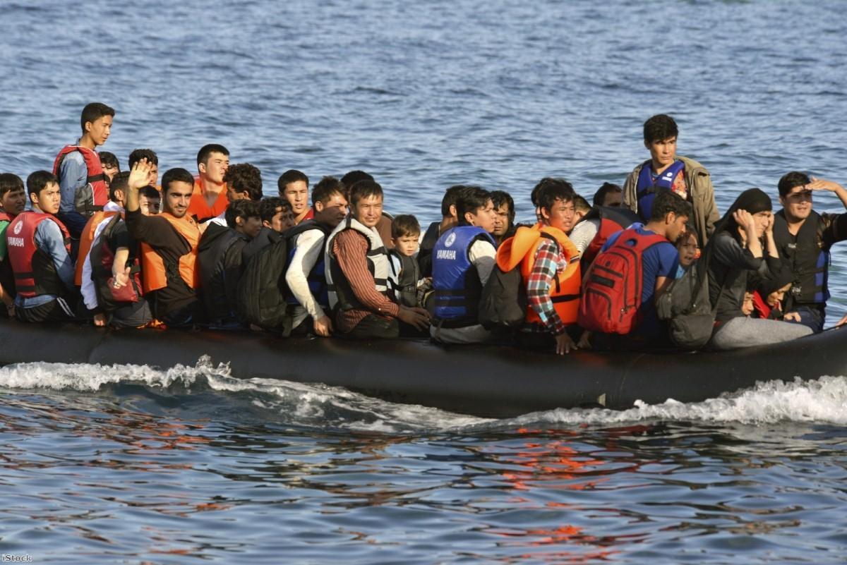 Refugees arriving at the Greek island of Lesbos