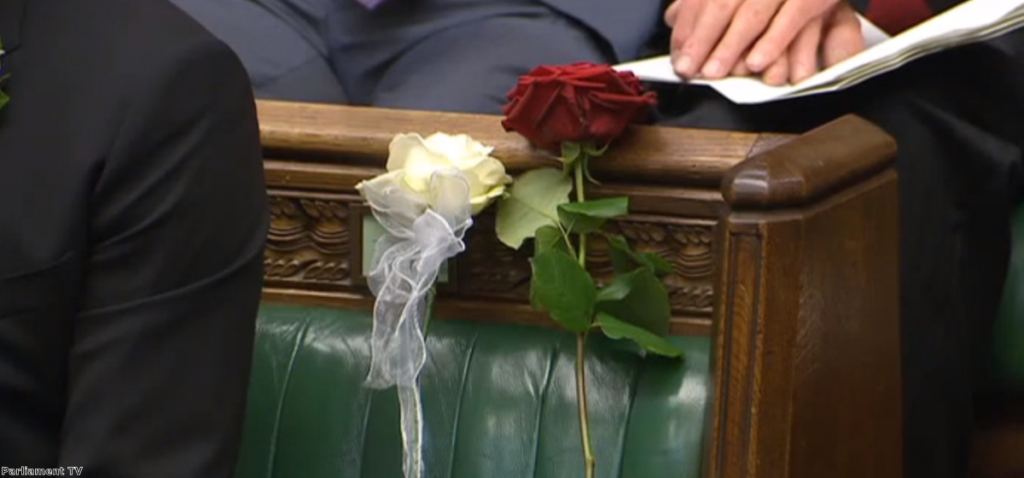 Two roses marked Jo Cox's seat in the Commons during yesterday's tributes
