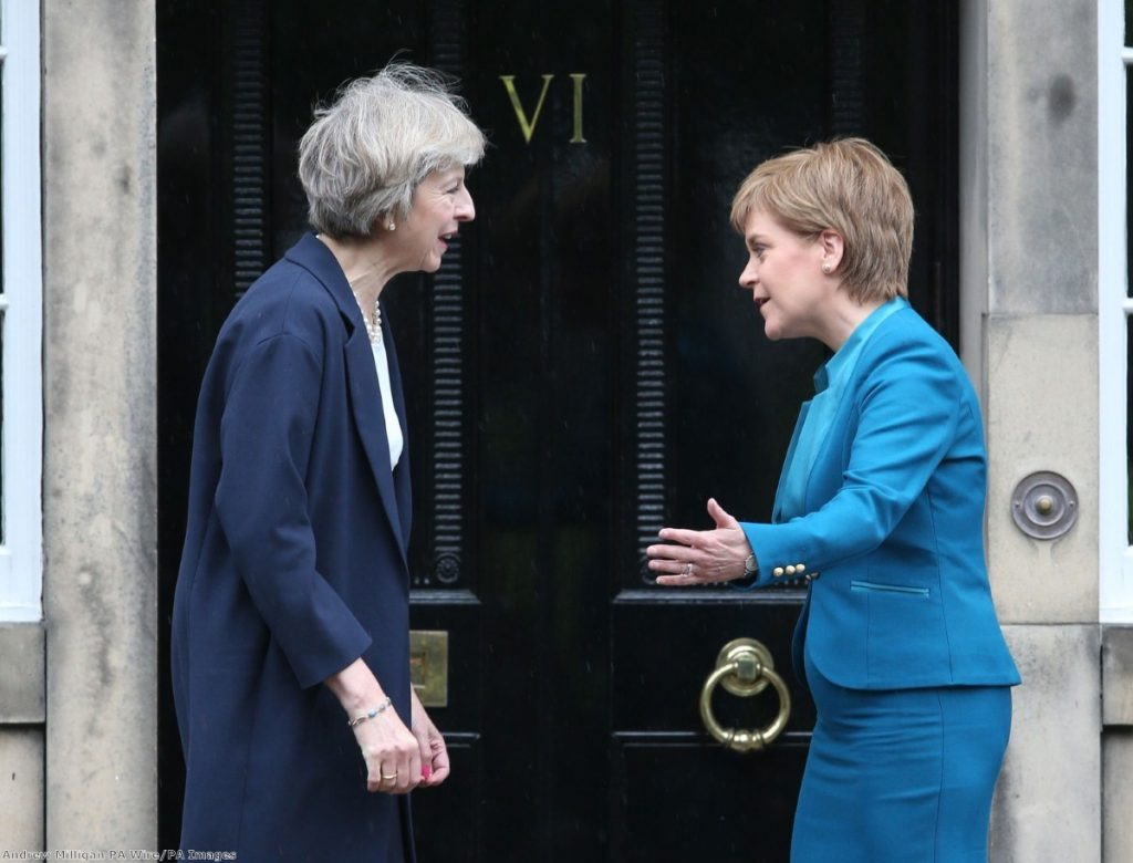Theresa May is greeted by Scotland's first minister Nicola Sturgeon at Bute House in Edinburgh