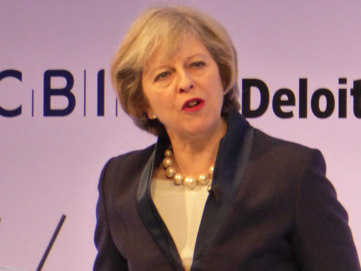 Theresa May ditches pledge to force companies to hand control to workers