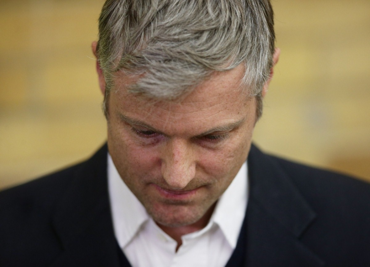 Zac Goldsmith looks dejected during a speech by victorious Lib Dem candidate Sarah Olney last night