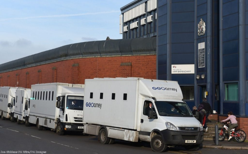 Custody vans wait to move prisoners out of HMP Birmingham after Friday's disturbance