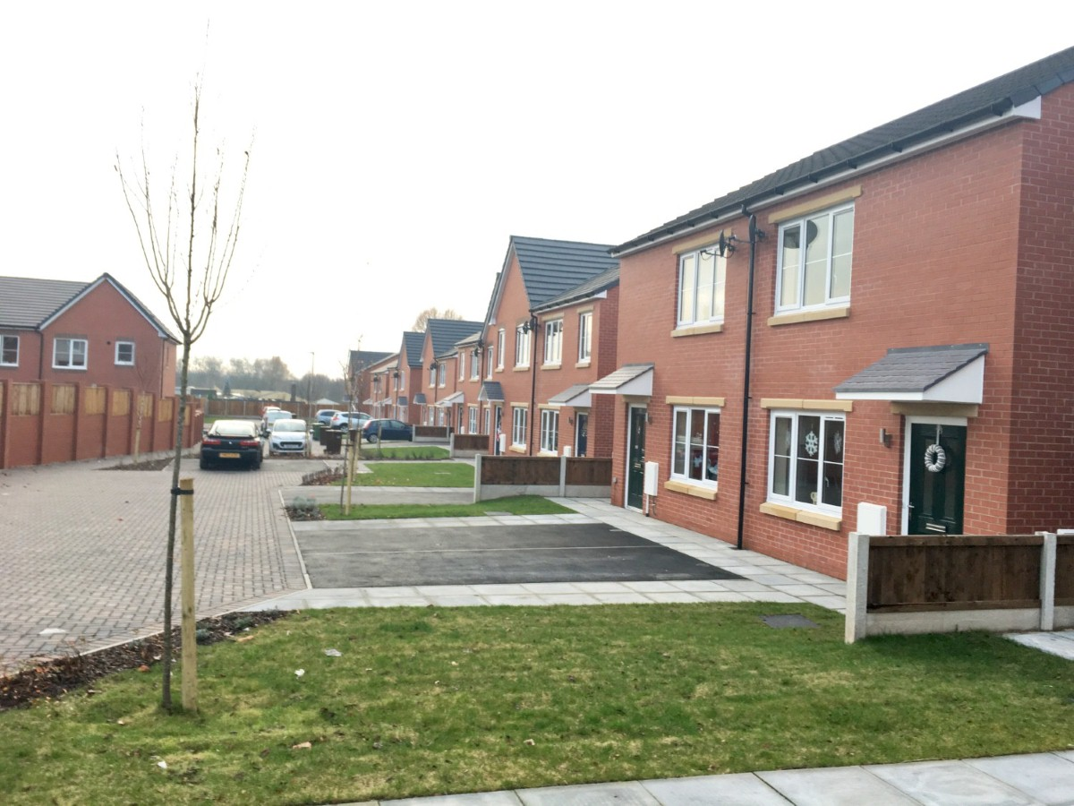 """""""In Wigan, a brand new estate is transforming lives, with residents describing their new homes as 'heaven'"""""""