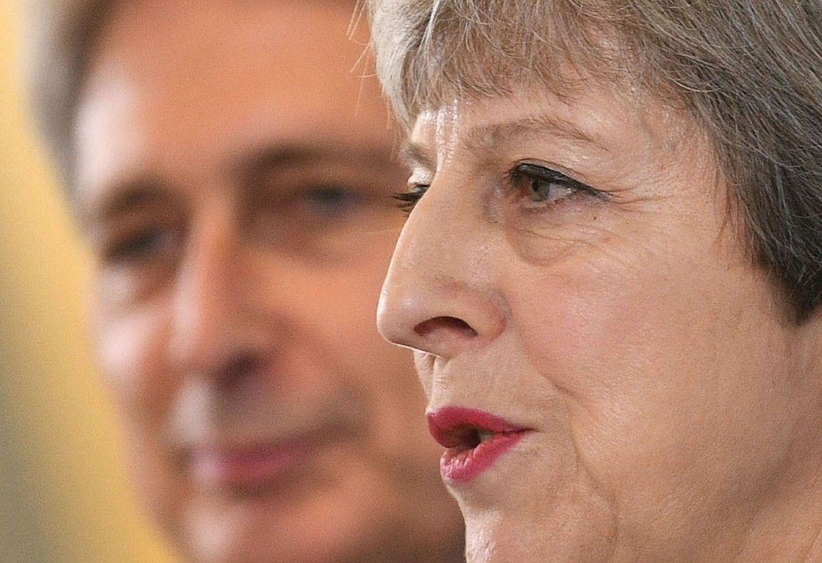 May and Hammond speaking in Canary Wharf in east London this morning