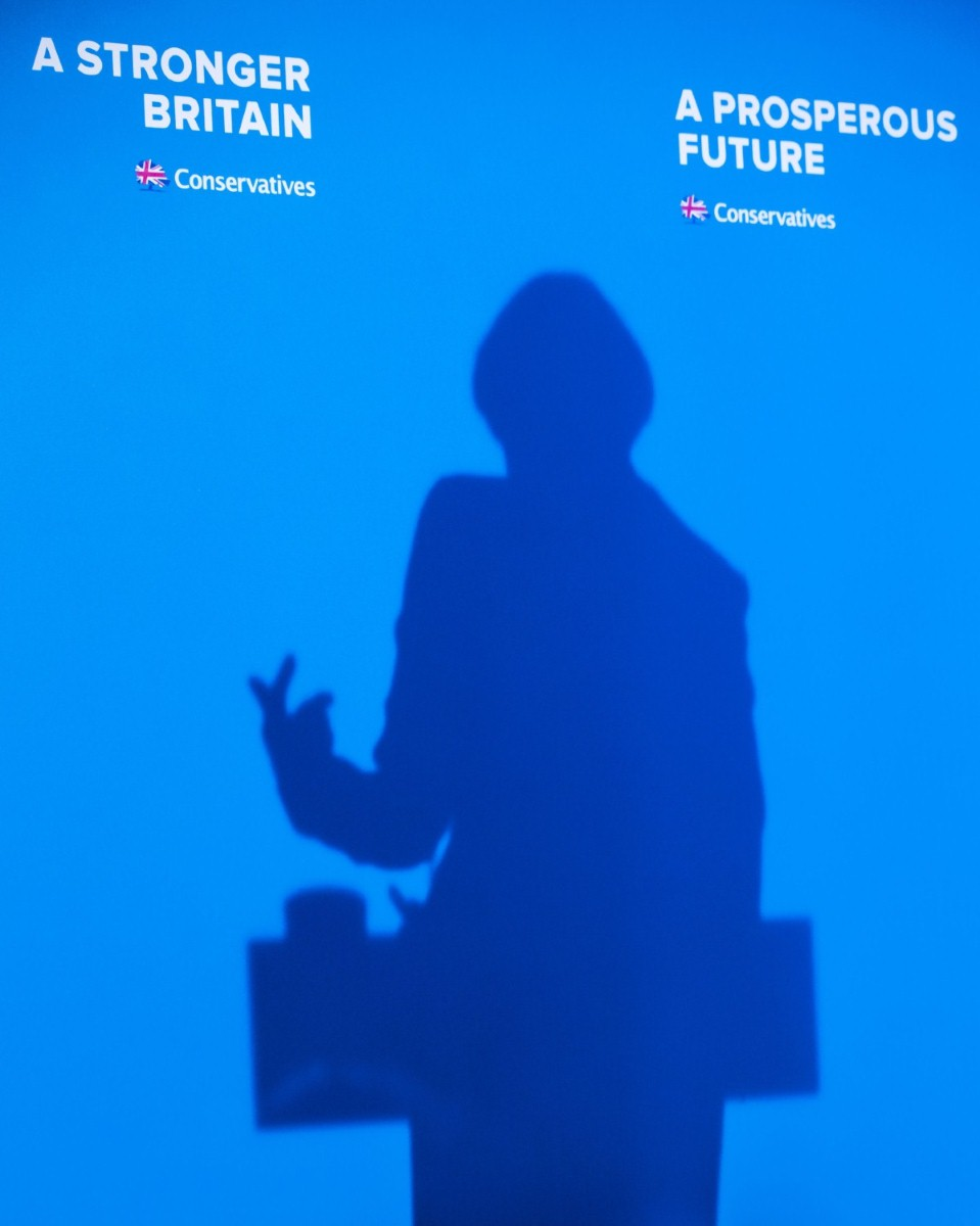 May's shadow against the wall as she unveils the Tory party manifesto
