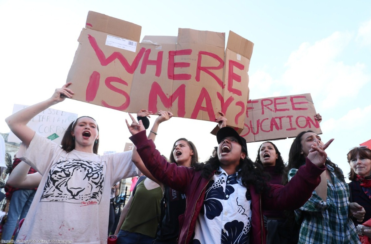 Protestors and supporters watch the arrival of the politicians who are taking part in the BBC Election Debate