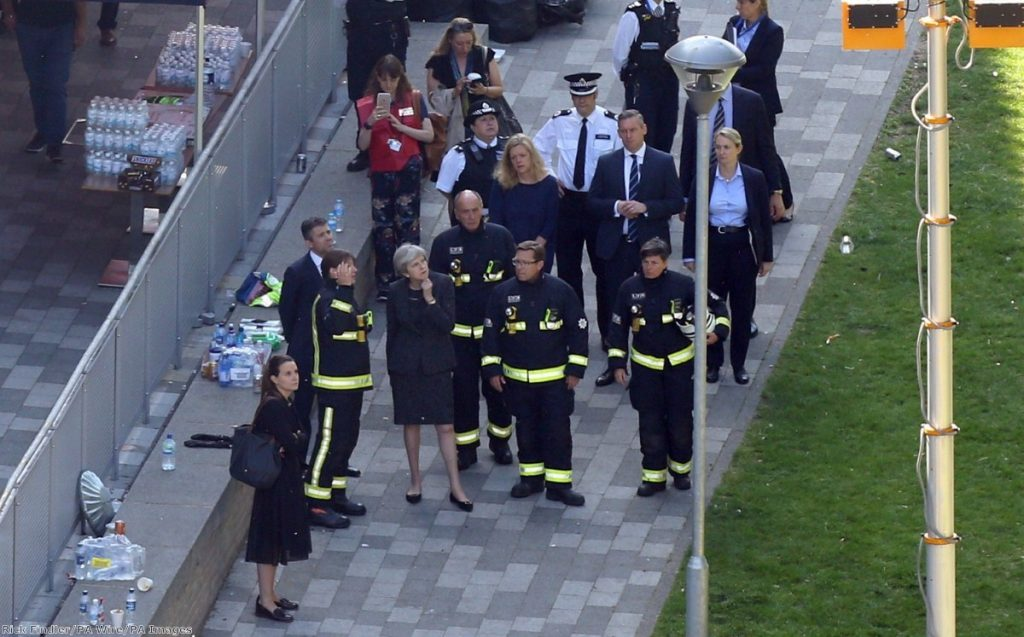 """Theresa May speaks with London Fire Commissioner Dany Cotton as she visits the scene near Grenfell Tower"""