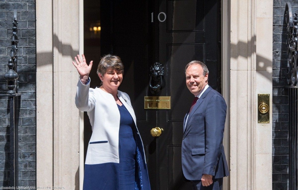 """""""The UK's prime minister is seeking support for her government in negotiations with a party leader who lost her hold on government over serious questions about the use of public funds."""""""