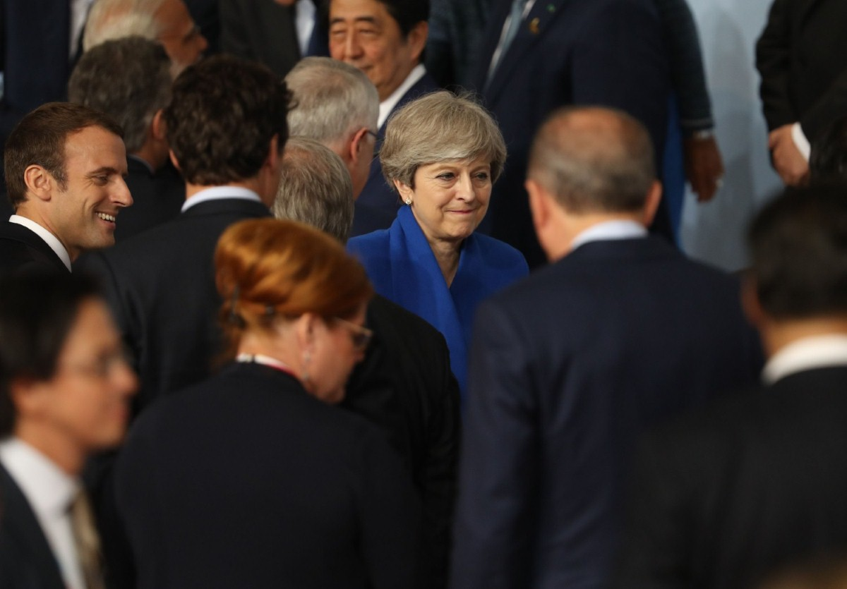 Theresa May cuts a lonely figure at the G20 summit on Friday morning