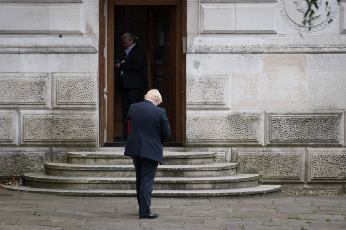 Boris Johnson enters the Foreign Office following a meeting in Downing Street over the summer
