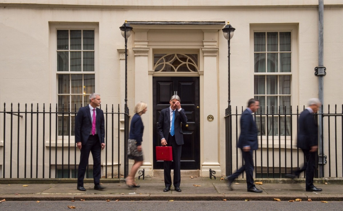 Stephen Barclay, Liz Truss, Mel Stride and Andrew Jones leave Philip Hammond with his red box outside 11 Downing Street this morning.
