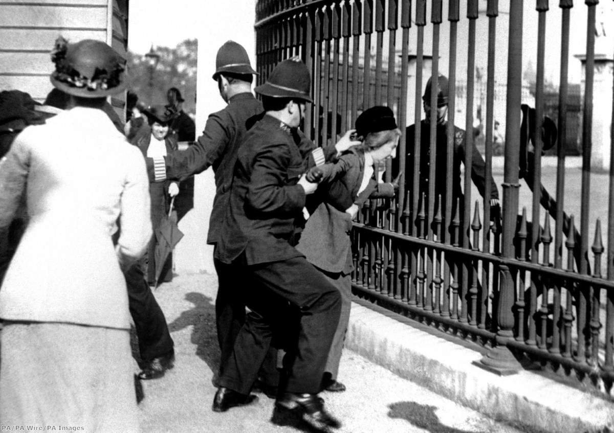 """""""A policeman restraining a demonstrator as suffragettes gathered outside Buckingham Palace"""""""