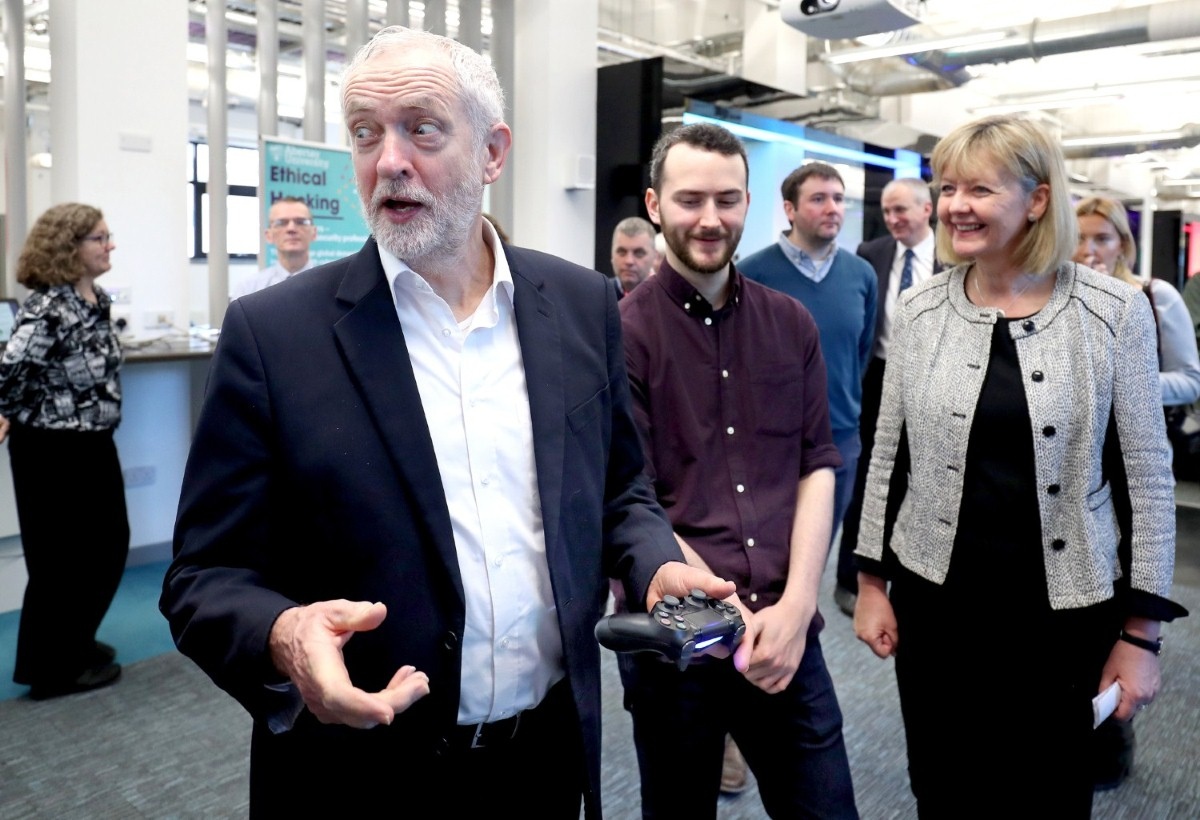 Jeremy Corbyn has a go at a PlayStation game developed by students, during the Scottish Labour conference in Dundee.