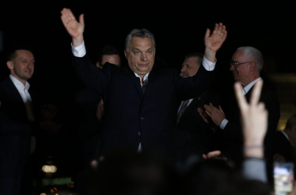 Hungarian prime minister Viktor Orban greets supporters in Budapest last night as preliminary results start coming through.