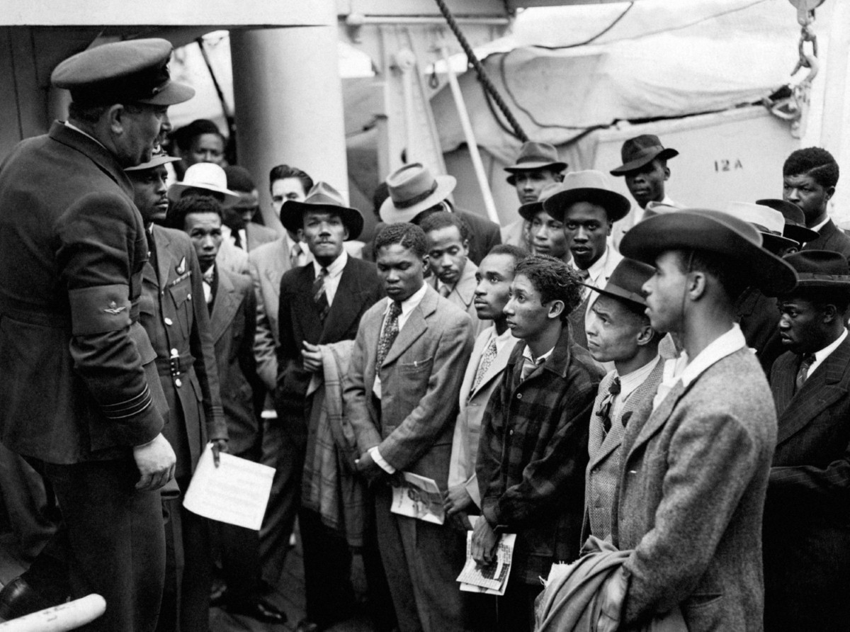 Jamaican immigrants are welcomed by RAF officials in 1948 as they arrive at Tilbury.