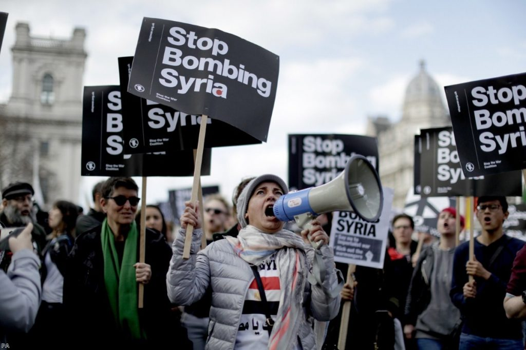 Demonstrators take part in a protest organised by the Stop the War coalition against the British government | Copyright: PA