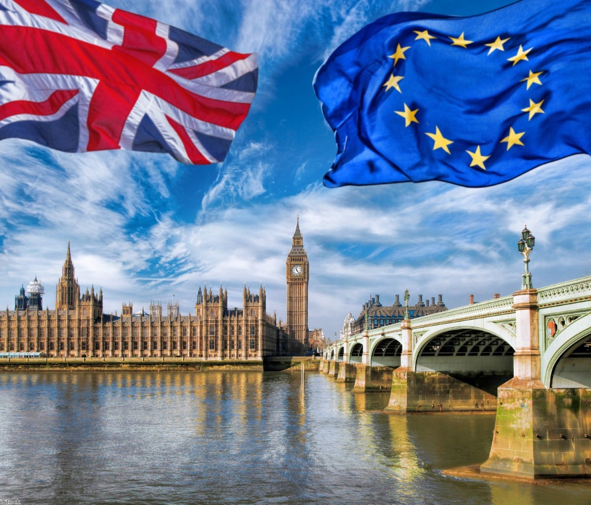 European Union and British Union flags flying against the Houses of Parliament   iStock