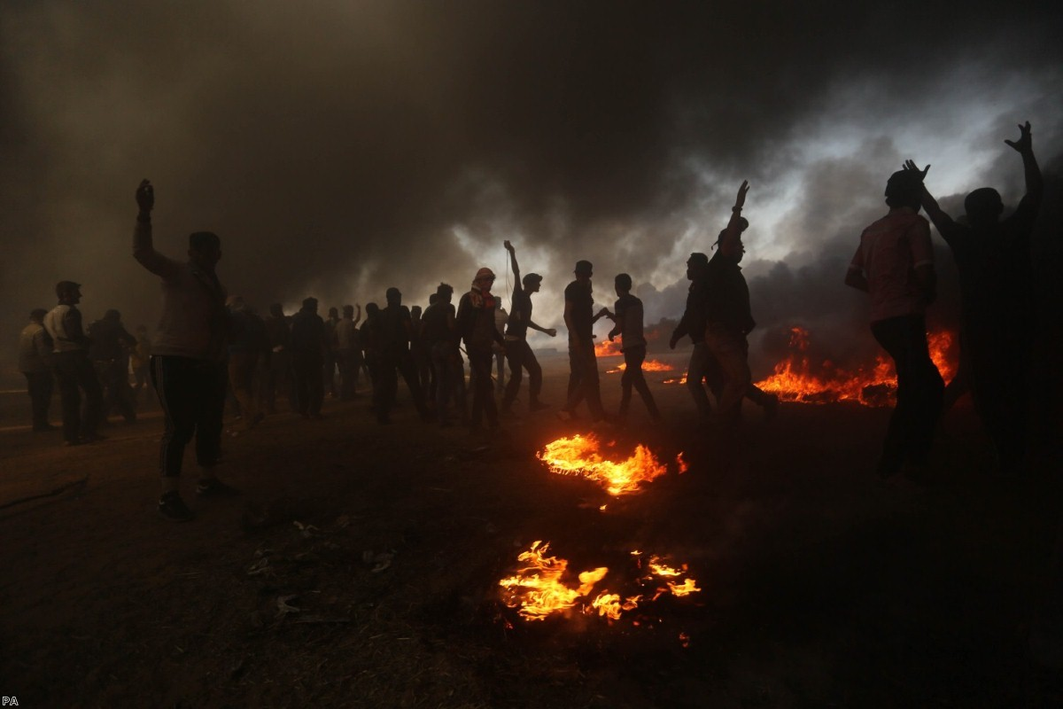 Palestinian protesters clash with Israeli soldiers at the border fence in the southern Gaza Strip | Copyright: PA