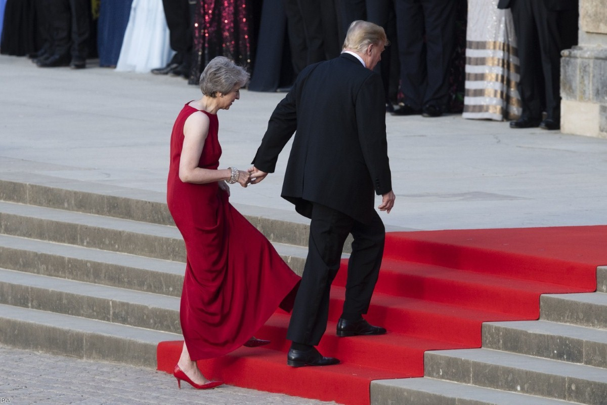 Donald Trump takes the hand of Theresa May as they enter Blenheim Palace on July 12, 2018 | Copyright: PA
