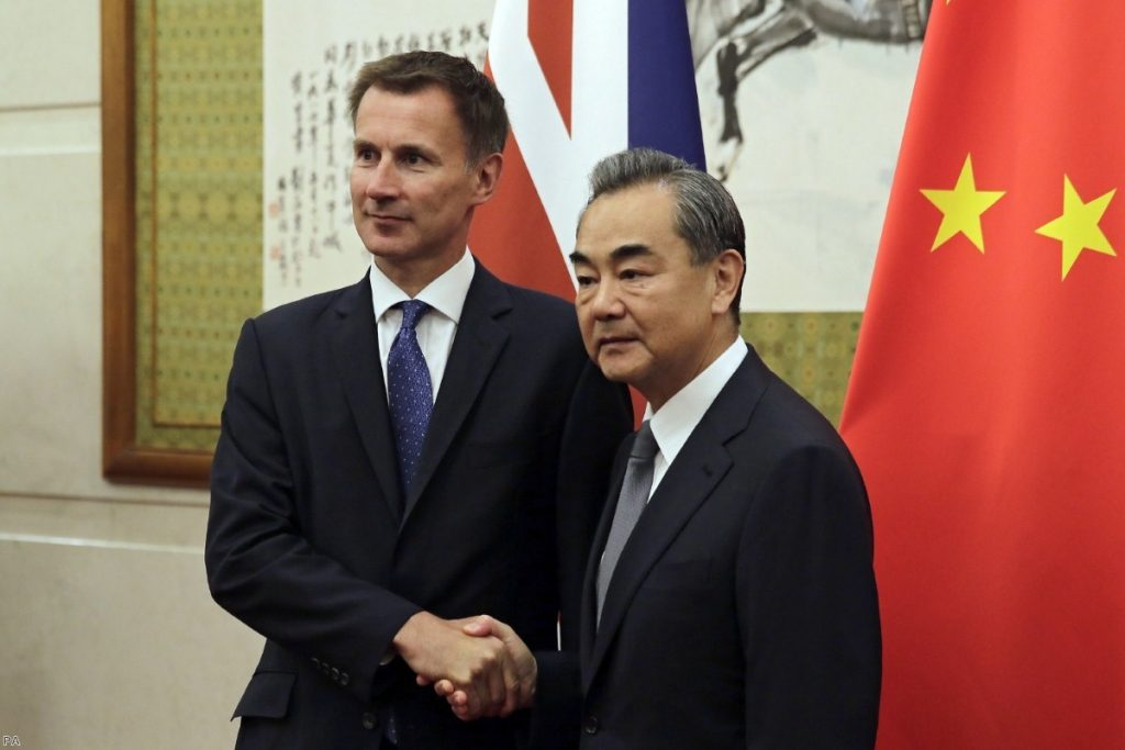 Jeremy Hunt shakes hands with Wang Yi before their meeting in Beijing   Copyright: iStock
