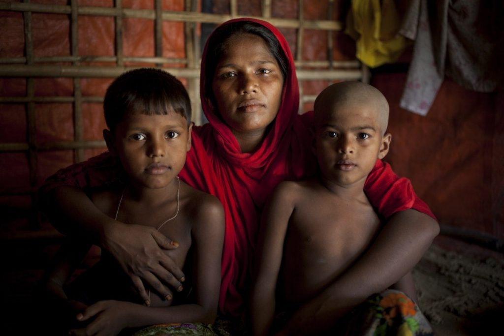 A Rohingya refugee cuddles her children in the camps in Cox's Bazar, Bangladesh. Copyright: Abbie Trayler-Smith/Oxfam