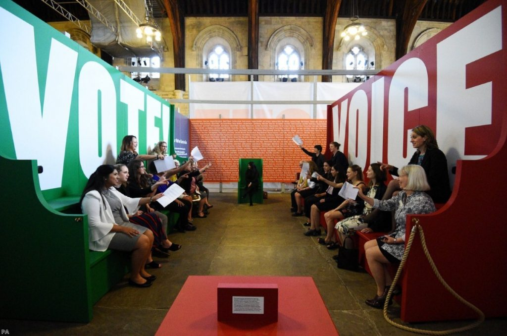 Visitors take part in a 'Parliamentary debate', during a preview of Voice & Vote: Women's Place in Parliament | Copyright: PA