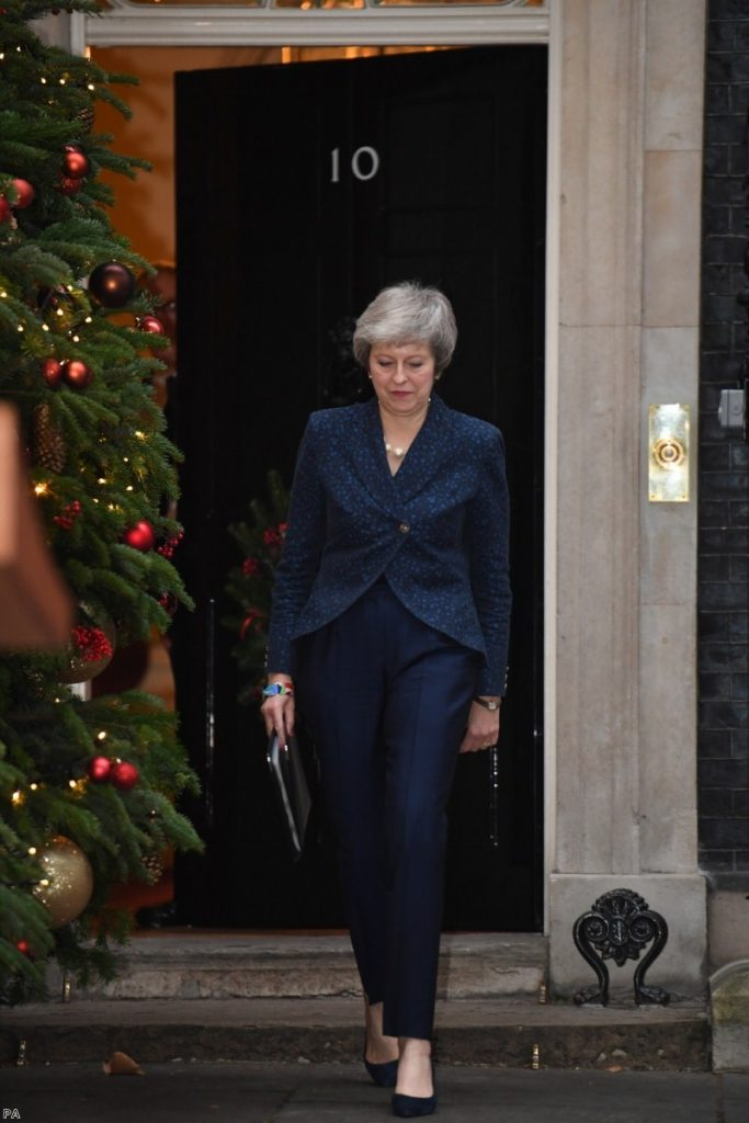 May walks out of Downing Street to make her statement this morning. She will face the no-confidence challenge in the evening.
