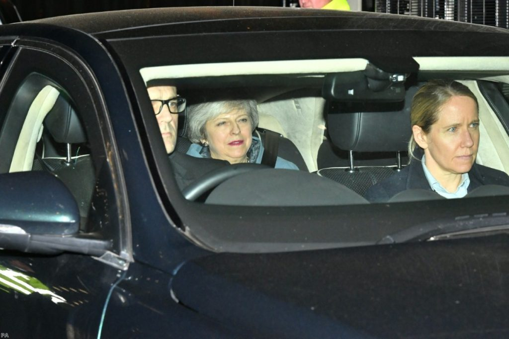 The prime minister leaves Westminster following a Brexit vote she did not attend.