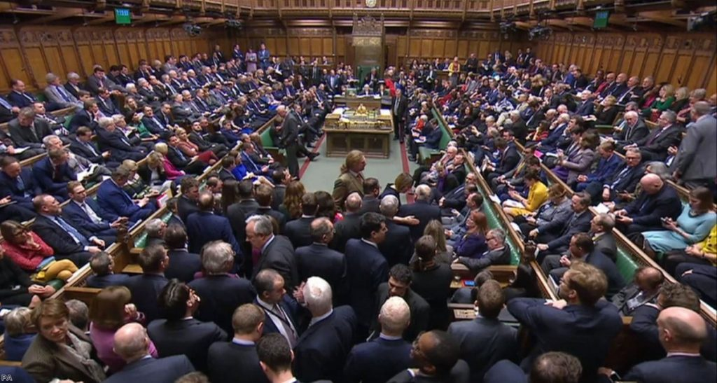 MPs gather in the Commons just before the full scale of the defeat was revealed