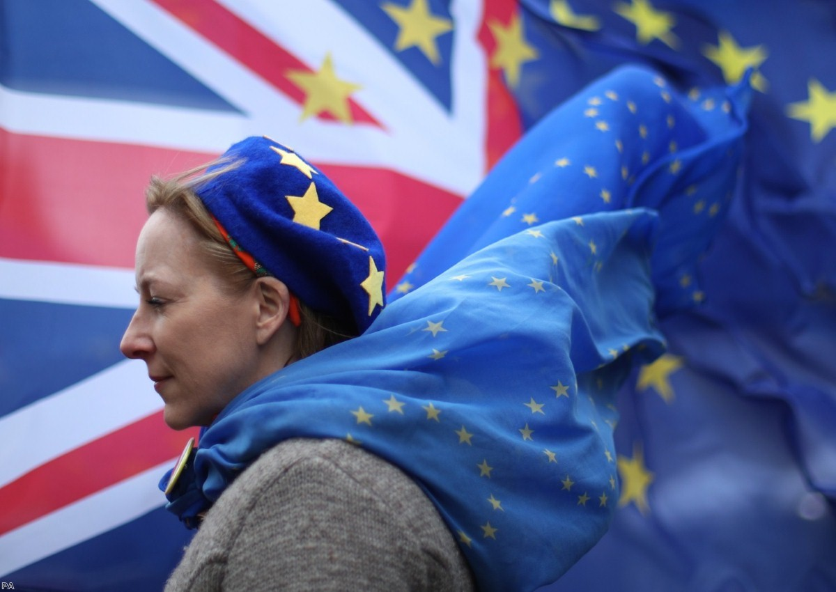 An anti-Brexit protester stands outside of parliament, on another day of high Commons drama