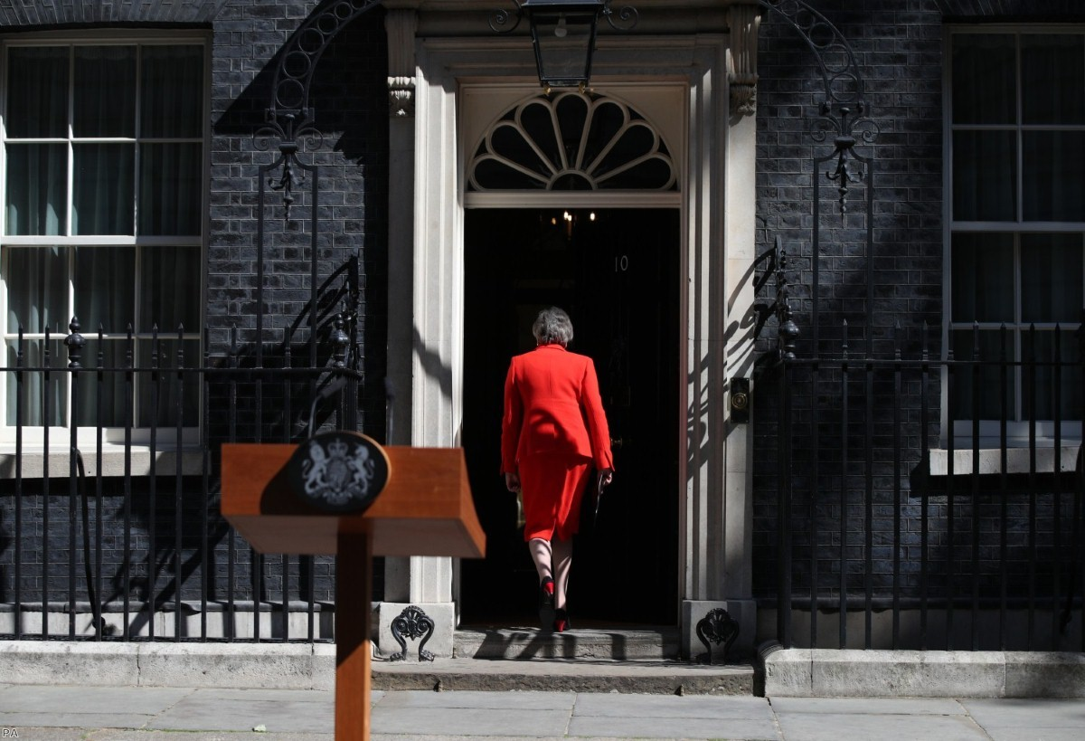 Theresa May walks back into Downing Street after announcing her resignation this morning.