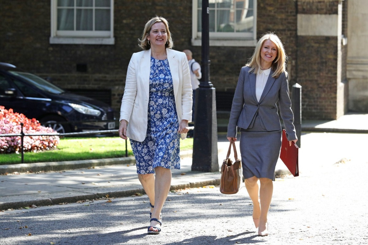Amber Rudd leaves Boris Johnson's first Cabinet meeting beside Esther McVey.