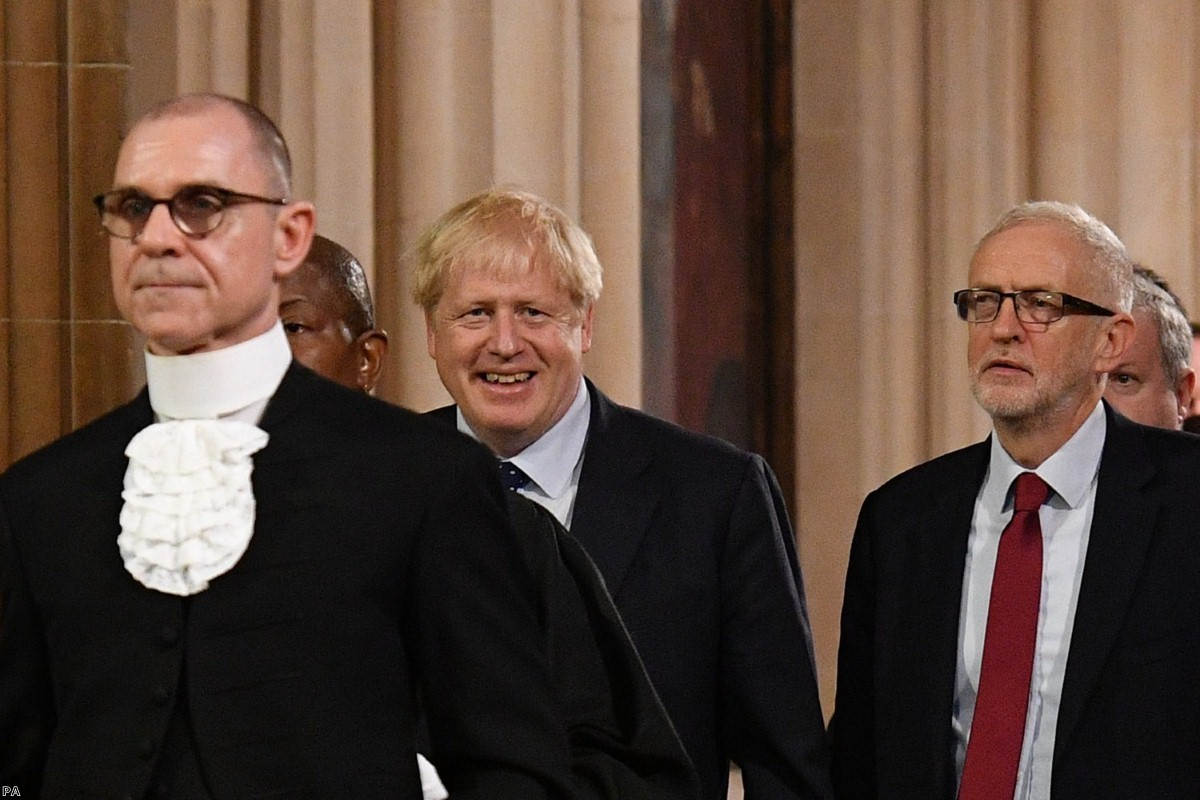 Boris Johnson and Jeremy Corbyn walk through Central Lobby after MPs were summoned to listen to the Queen's Speech today.