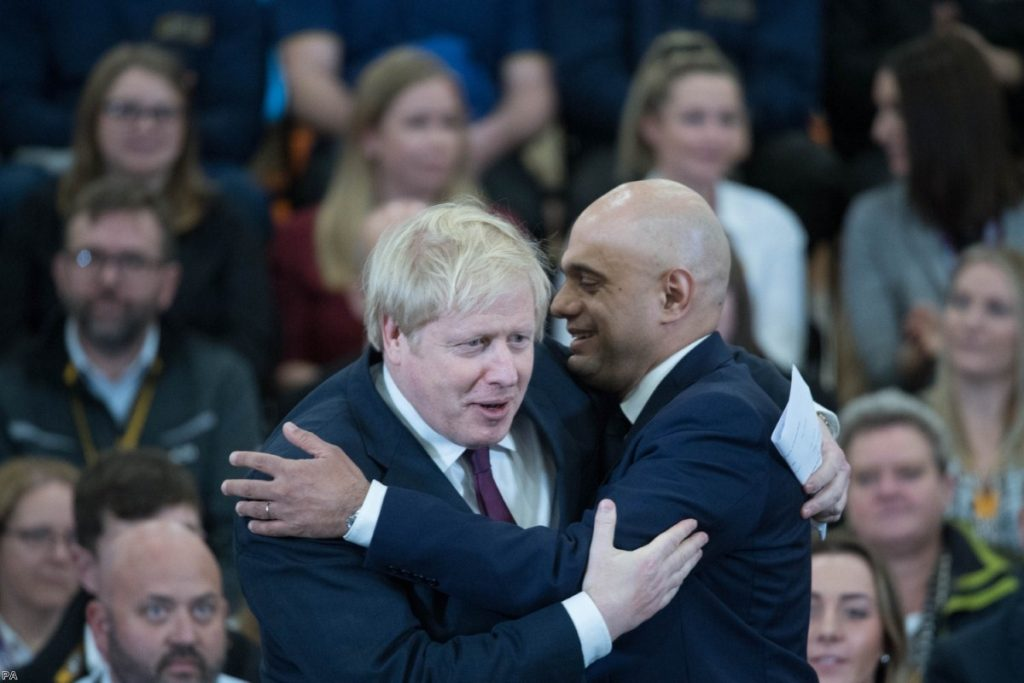 Javid and Johnson embrace during the election last year. This morning, the chancellor resigned.