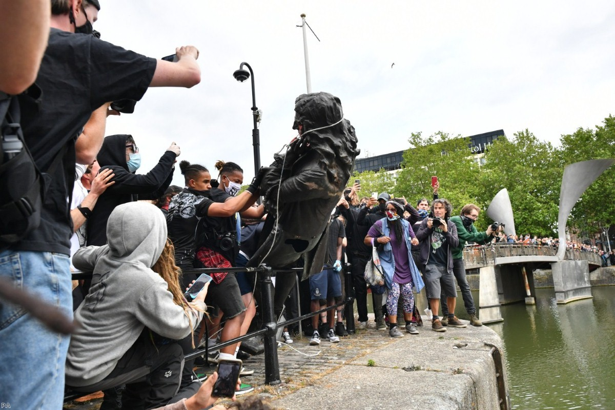 Protesters throw a statue of Edward Colston into Bristol harbour during a Black Lives Matter protest last weekend.