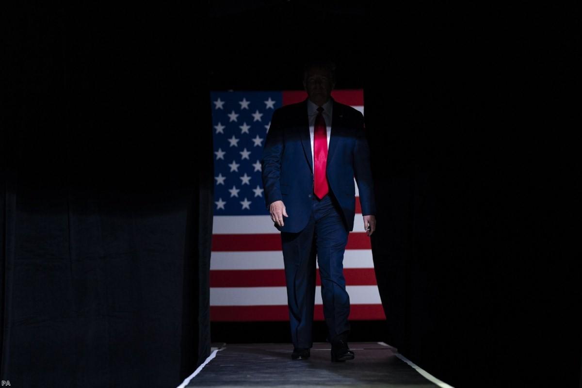 President Trump arrives on stage in Tulsa, Okla.