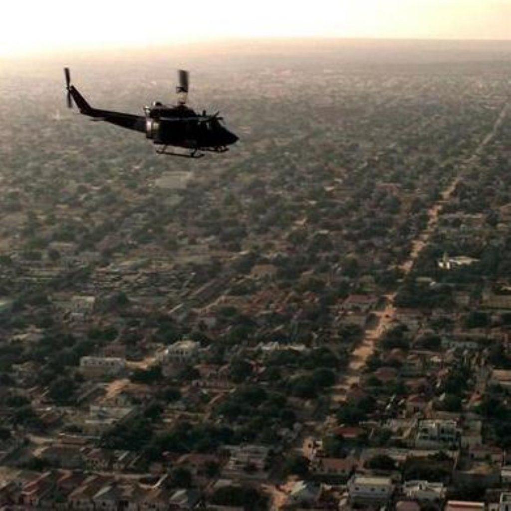 A helicopter flies over Mogadishu, Somalia