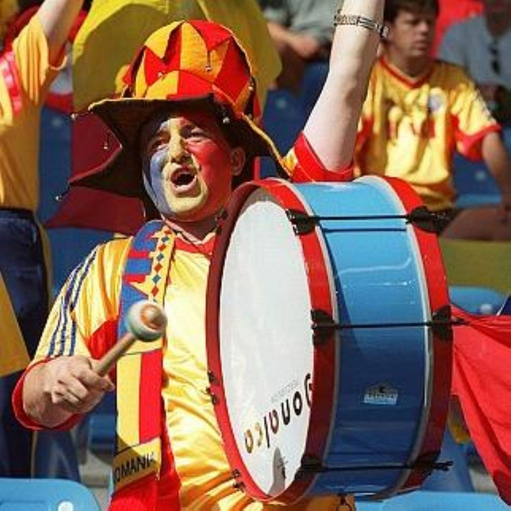 A Romanian fan beats the drum for his team. In December, controls on Romanian movement within the EU will be lifted.