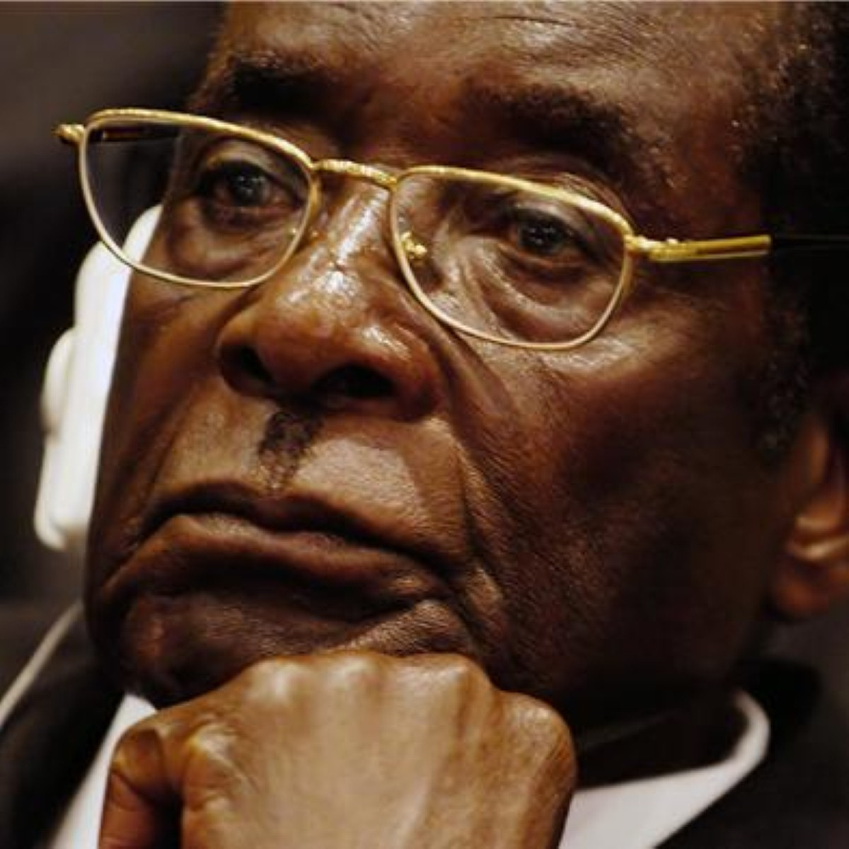 """David Miliband brands Robert Mugabe a """"stain"""" on Zimbabwe and calls on renewed efforts to remove him from power"""