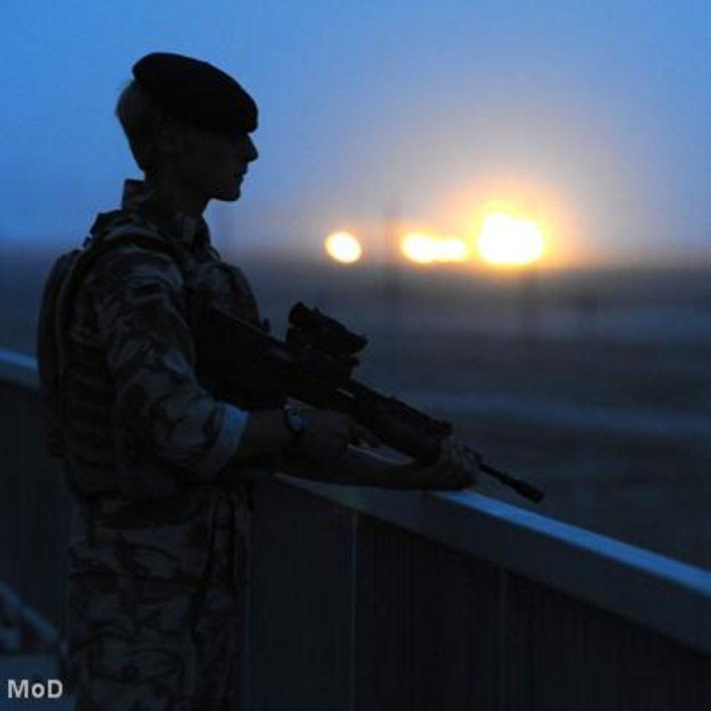 A British troop stands watch in Iraq