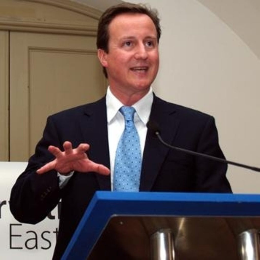 Cameron backed his director of communications today
