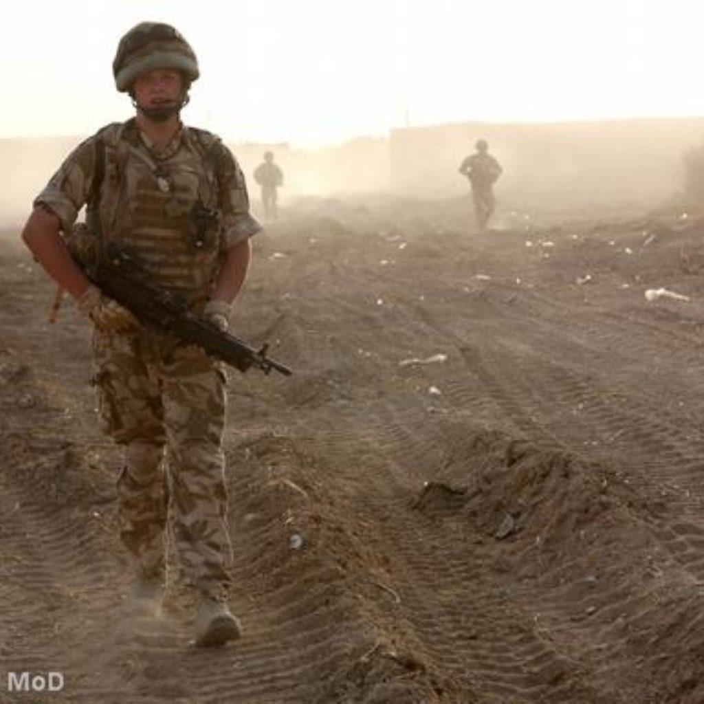 A British soldier patrols in Afghanistan