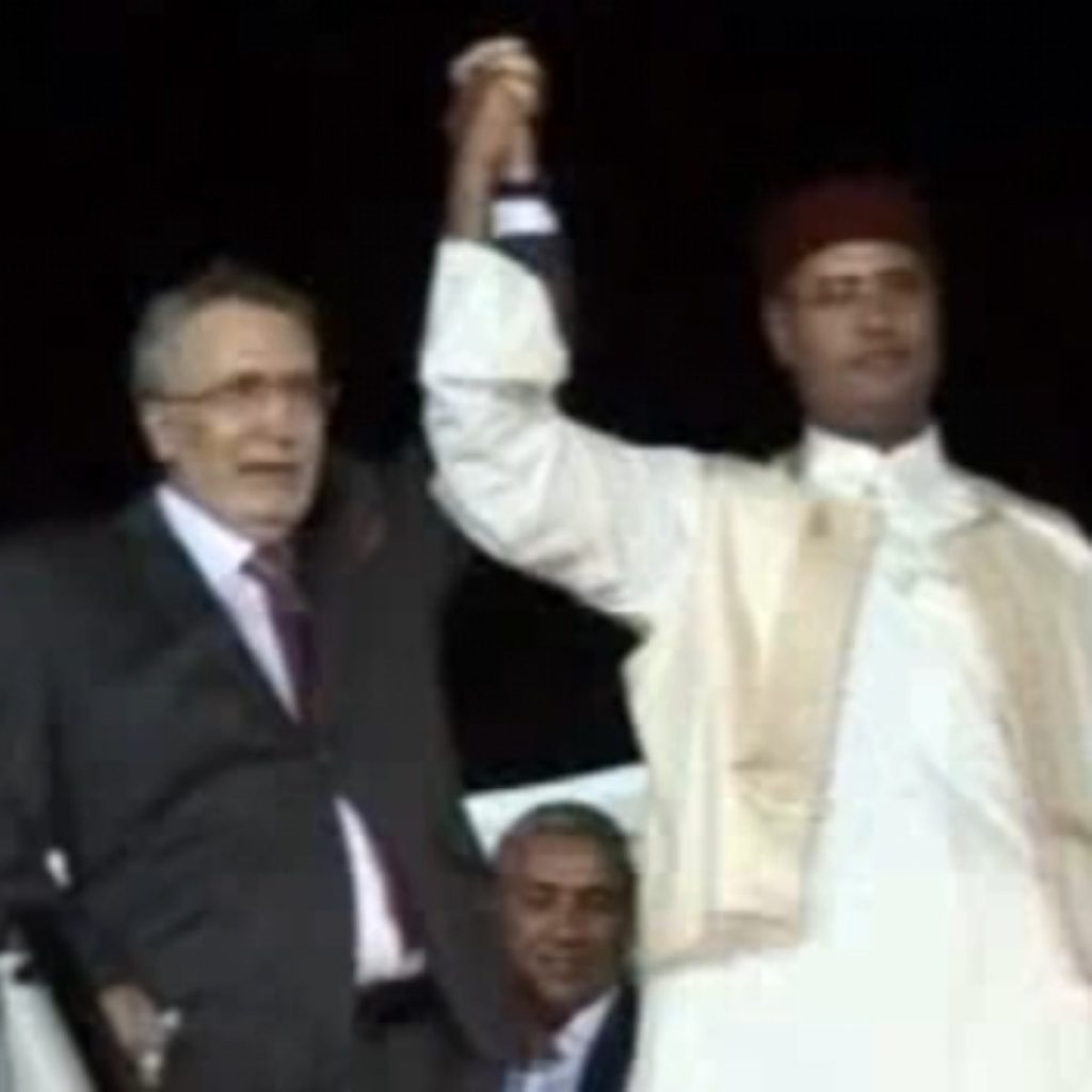 Abdelbaset al-Megrahi (l) was hailed by Libyan leaders on his return