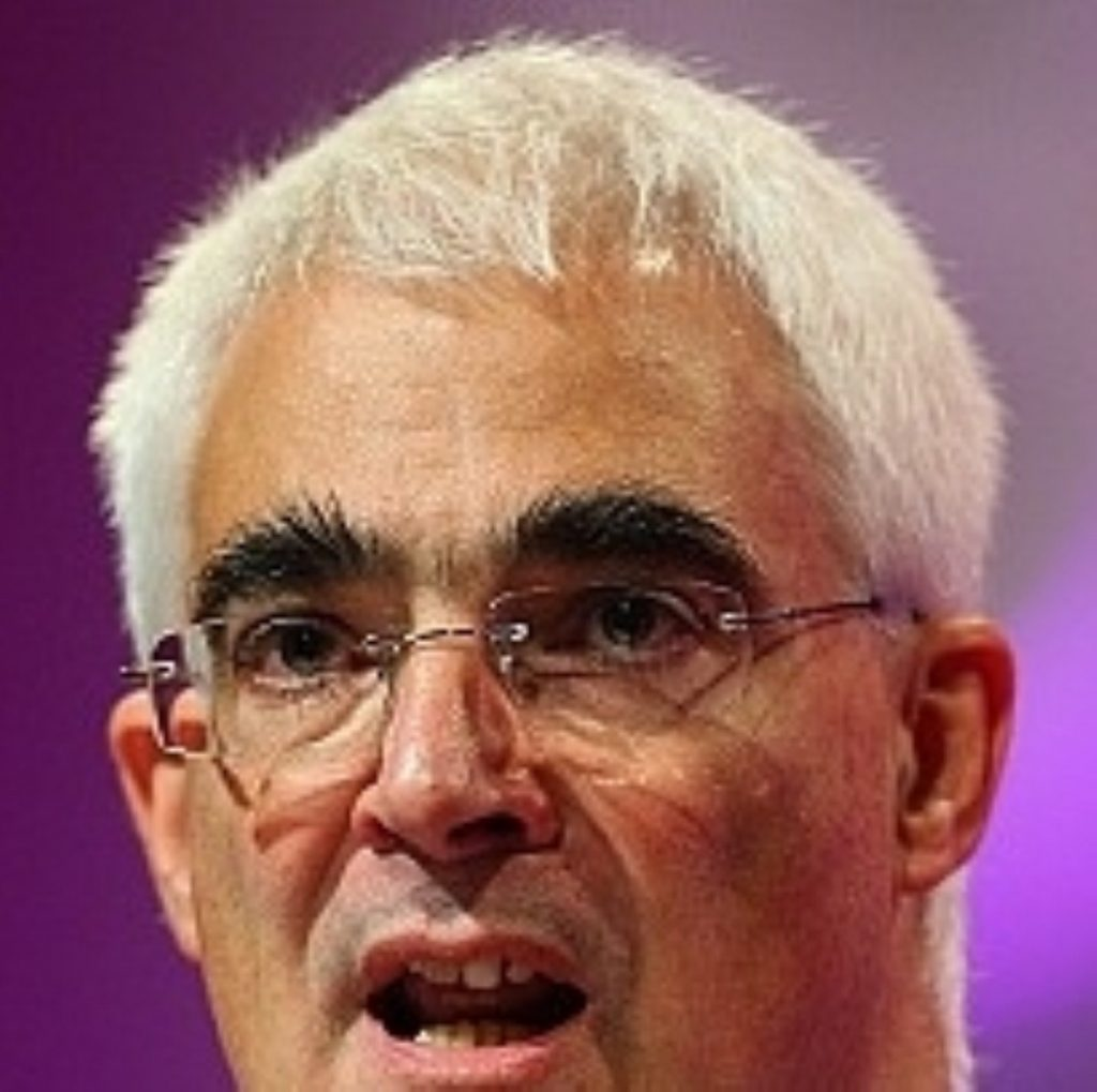 Alistair Darling defended government's massive borrowing commitment