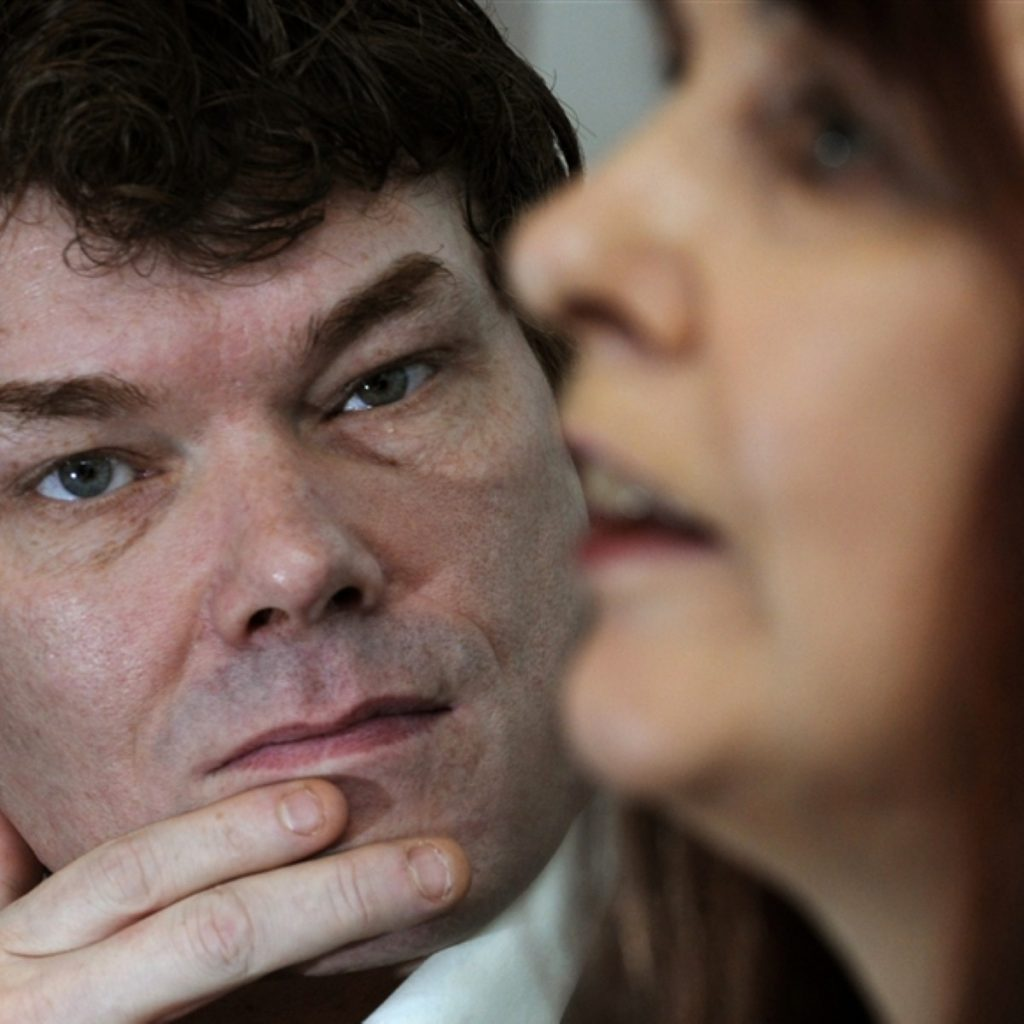 GaryMcKinnon watches his mother, Janis Sharp, as they campaign against his extradition