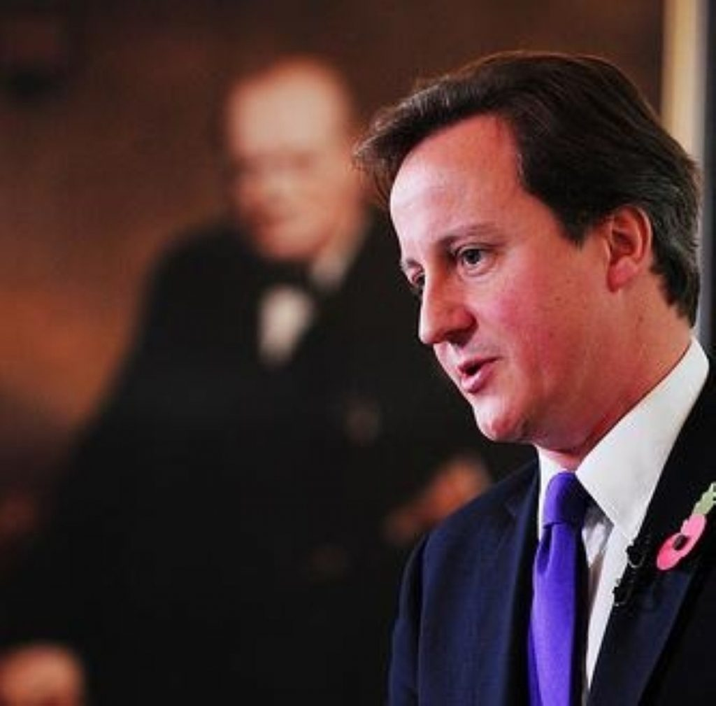 David Cameron delivers his monthly press conference, as Churchill looks on