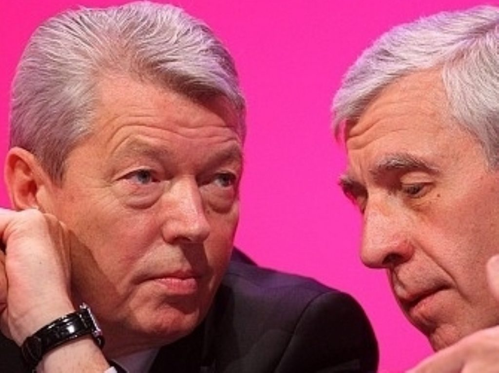 Alan Johnson talks with Jack Straw.Both men defended Labour's civil liberties record today.